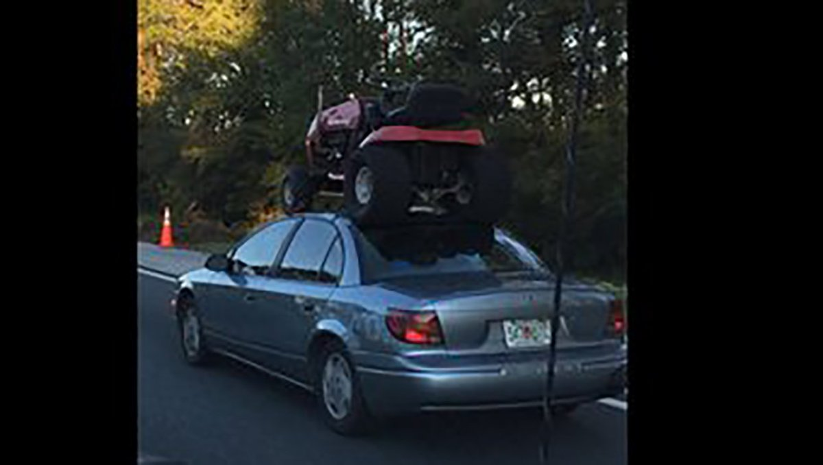 Florida driver straps riding lawn mower to car roof