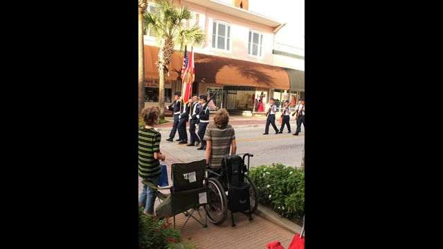 Florida teen in wheelchair tries to stand when American flag passes
