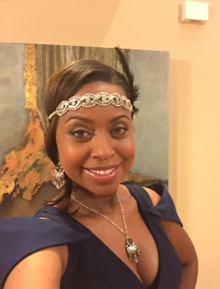 Embracing theme before emceeing tonight's KCEF Great Gatsby Gala. charity