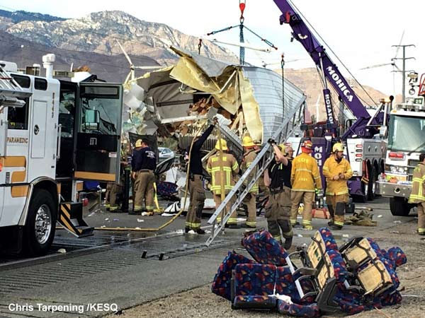 At least 11 dead after tour bus, truck crash in California
