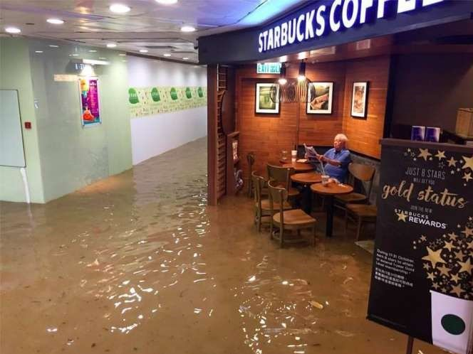 Memes flow after man calmly sips coffee in flooded Starbucks