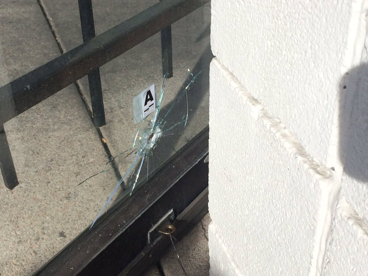 A bullet hole in the front door from a shooting this morning. @9NEWS