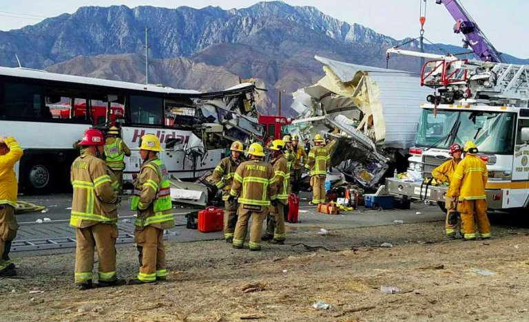 Tour bus hits truck, killing 13, injuring 31 in Southern California.