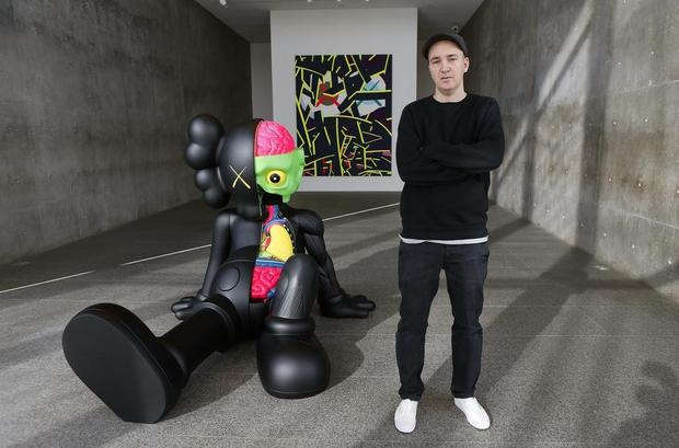 Cartoons bear message in art with a KAWS