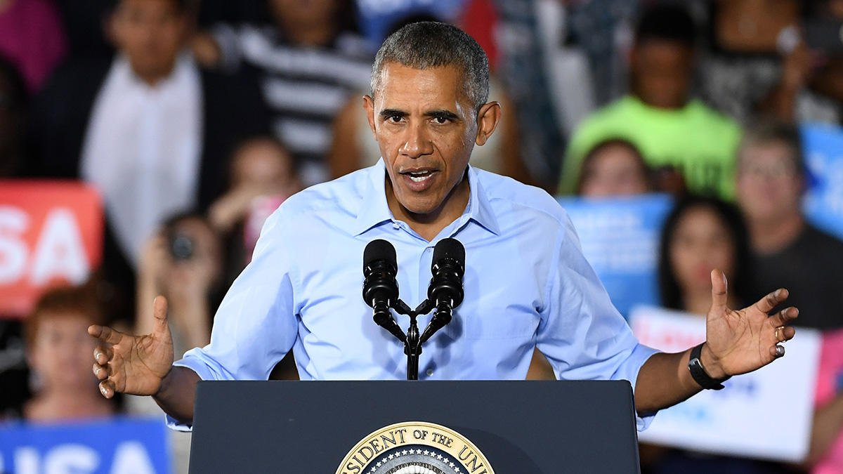 Obama says Hillary Clinton, democrats are a winning hand