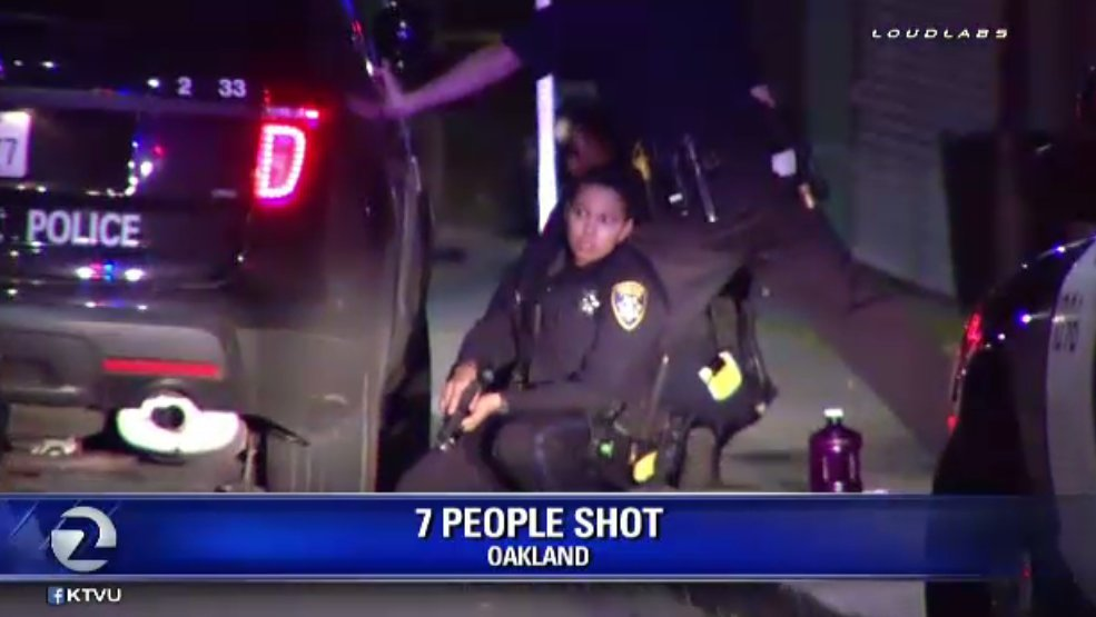 OPD officers take cover after gunfire at 77th & Bancroft leaves 7 people wounded.