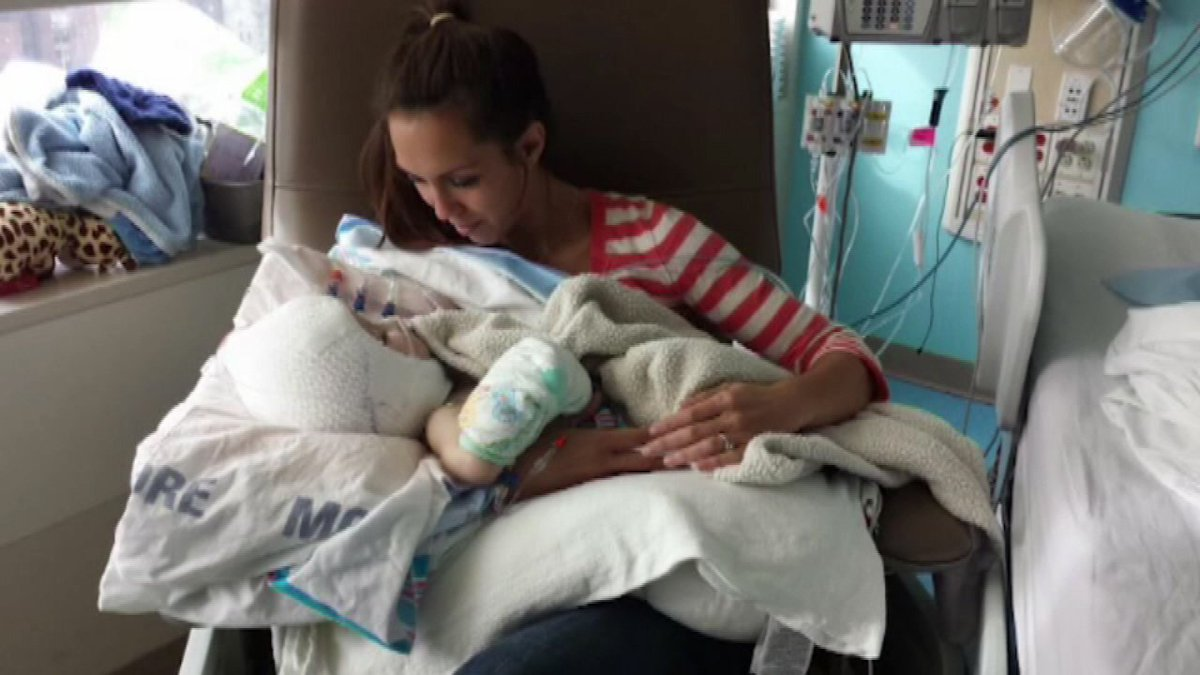 Mother of separated conjoined twins holds son alone for the first time