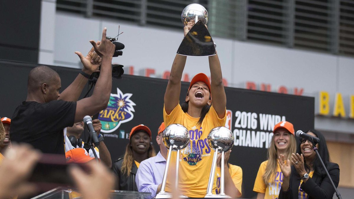 Los Angeles Sparks celebrate WNBA championship with their trophy and their fans