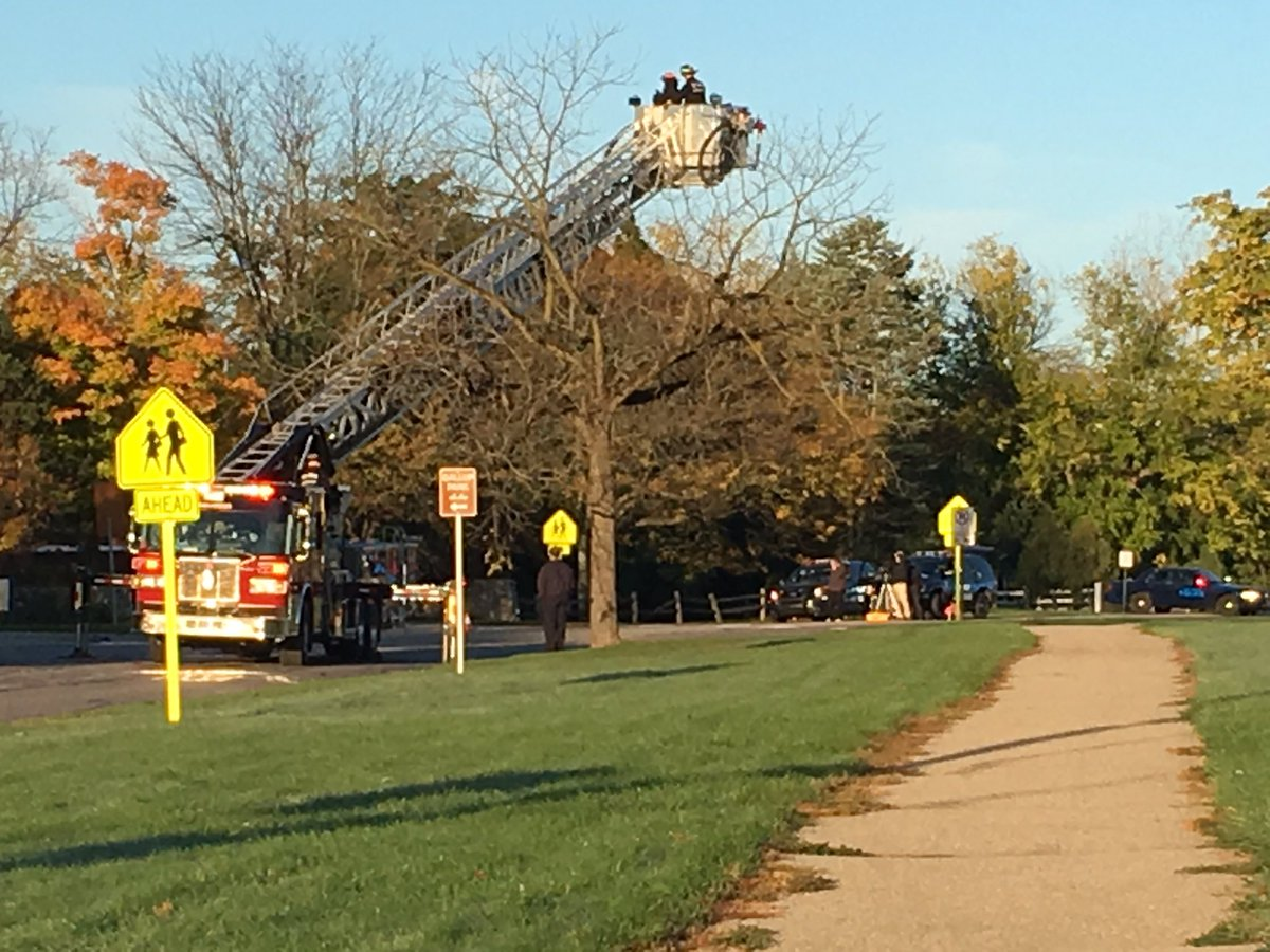 Ann Arbor fire fighters using their ladder truck to help police take aerial photos after ped/car crash on Fuller Rd.