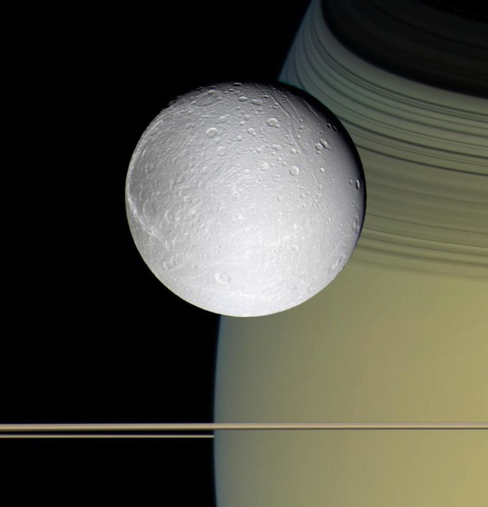The two faces of moon Dione: One side lit by sunshine, the other lit by Saturn-shine. (Processing by @kevinmgill)