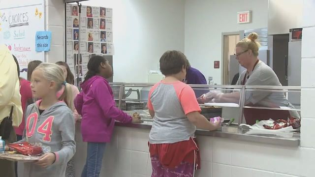 Man pays overdue school lunch fees for nearly 100 children