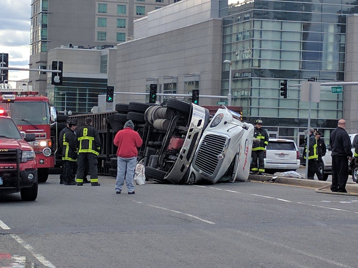 A truck overturns by the Convention Center in the Seaport.