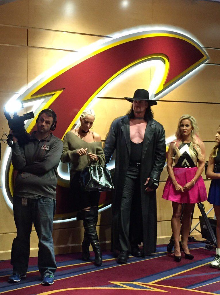 The Undertaker is standing outside the Cavaliers locker room. Further context is unavailable. https://t.co/8MWhPJarju