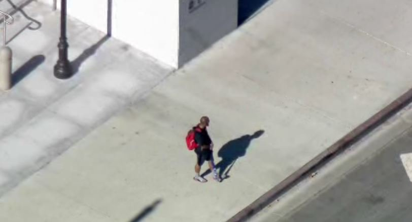 LAPD negotiating with man holding baseball bat outside Hall of Justice building in DTLA