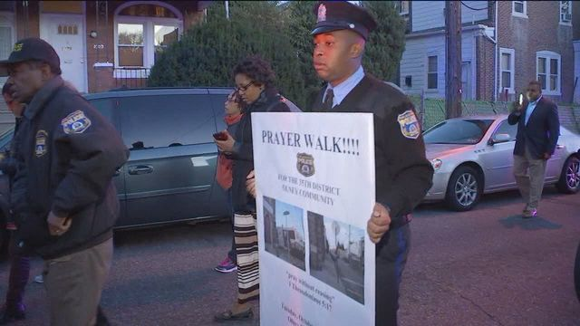 Cops and residents pray together in Olney