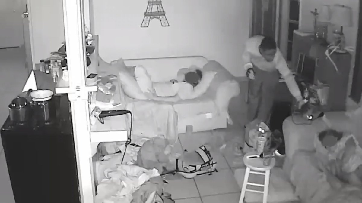 Brazen burglars sneaking past sleeping children caught on camera.