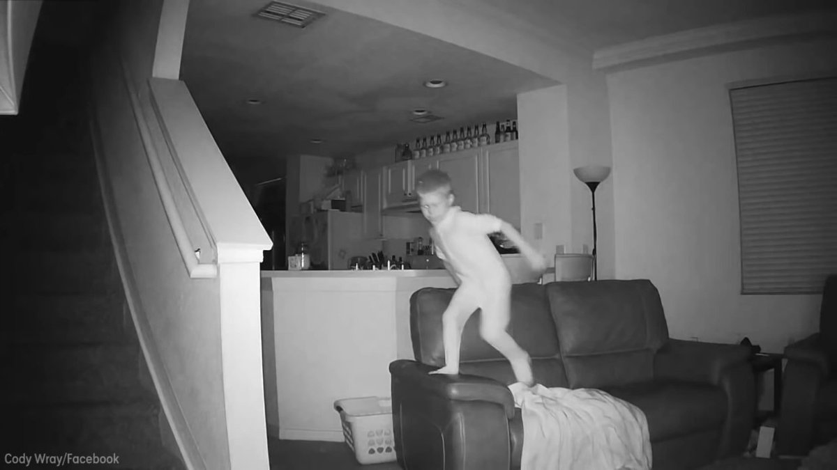 Home security camera captures boy's late-night couch jumping