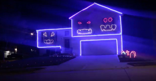This 'Go Cubs Go'-singing Halloween light show is as amazing as it is unsettling