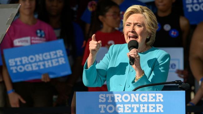 Hillary Clinton wants review of AT&T-Time Warner deal but says little else