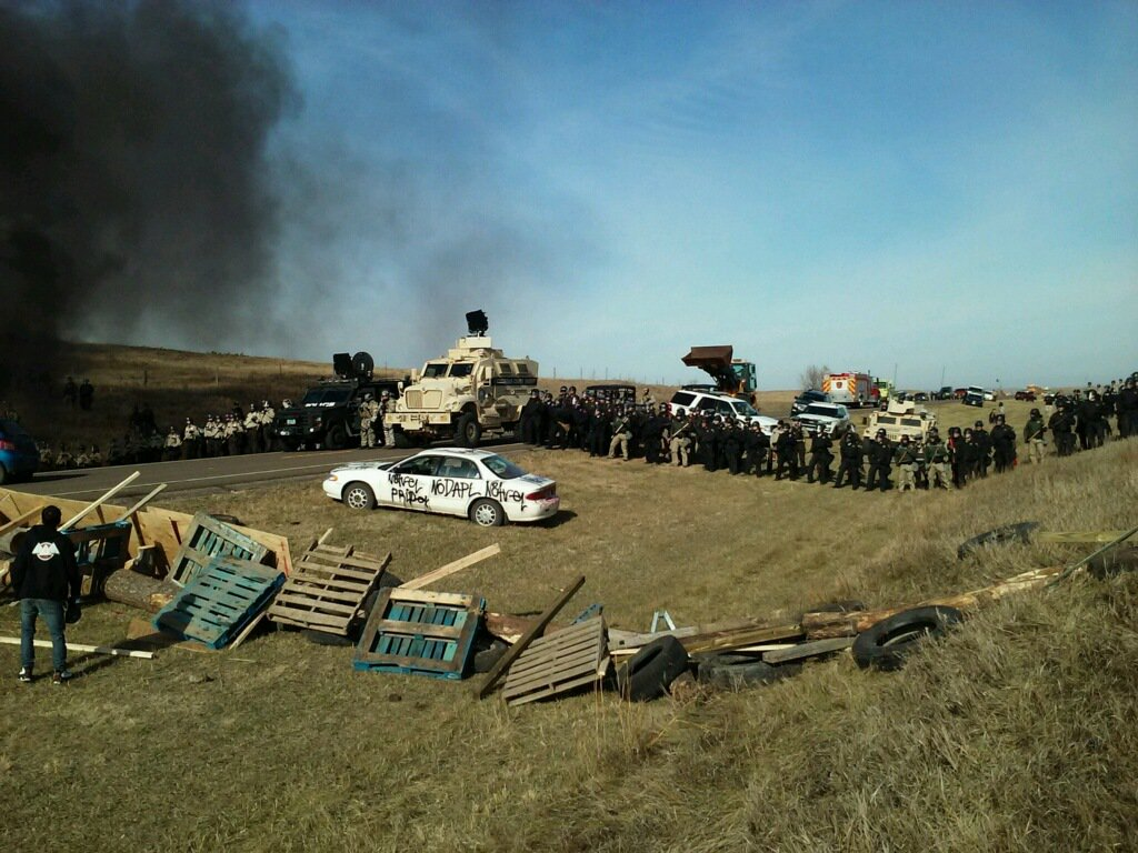 Happening now: 100+ Police in ND approaching #NoDAPL frontline resistance camp with multiple MRAPs, sound cannon, armored truck, bulldozer