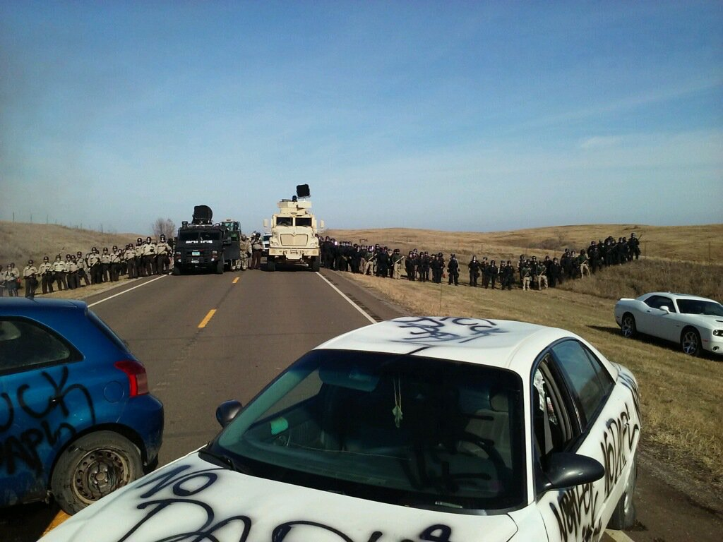 BREAKING: 100+ police in riot gear appear poised to raid #NoDAPL resistance camp directly in path of Dakota Access pipeline construction