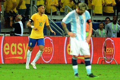Brazil under inspiration of Neymar roared to an impressive World Cup qualifying 3-0 defeat over Argentina in their first game at the Mineirao Stadium