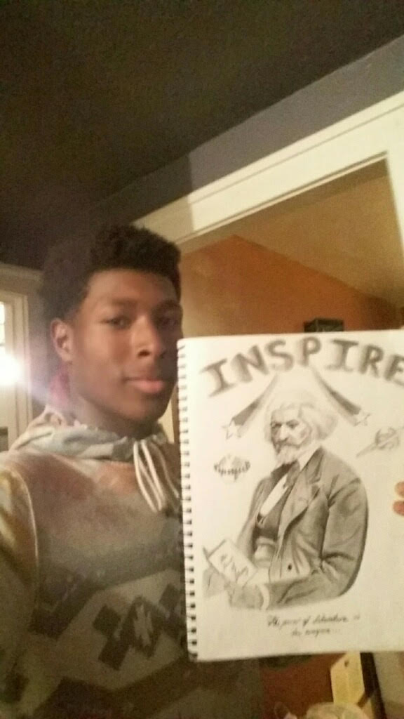 And here's the selfie Yoshua took with the original drawing of Frederick Douglass #thepowerofliteracy2016 https://t.co/D0ruNqLKPK