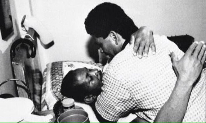 Roberto Duran hugs his former bitter rival Esteban DeJesus on his deathbed in 1989 (when most were too afraid to touch AIDS patients).