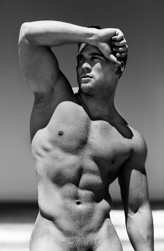 Naked handsome man, sexy muscular body, black and white photo