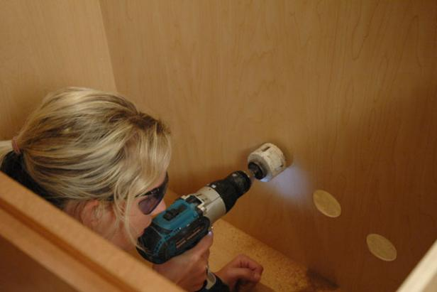 A hole saw will prep your kitchen sink cabinet for installation. DIY