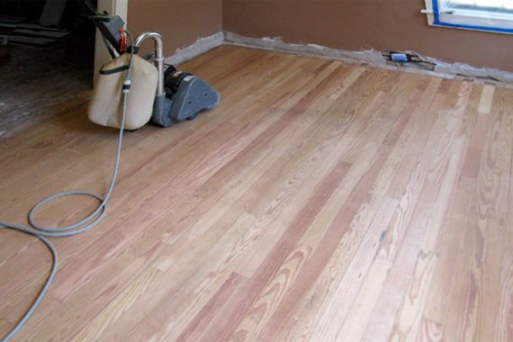 Would you hire a contractor or DIY when it comes to refinishing your hardwood floors?