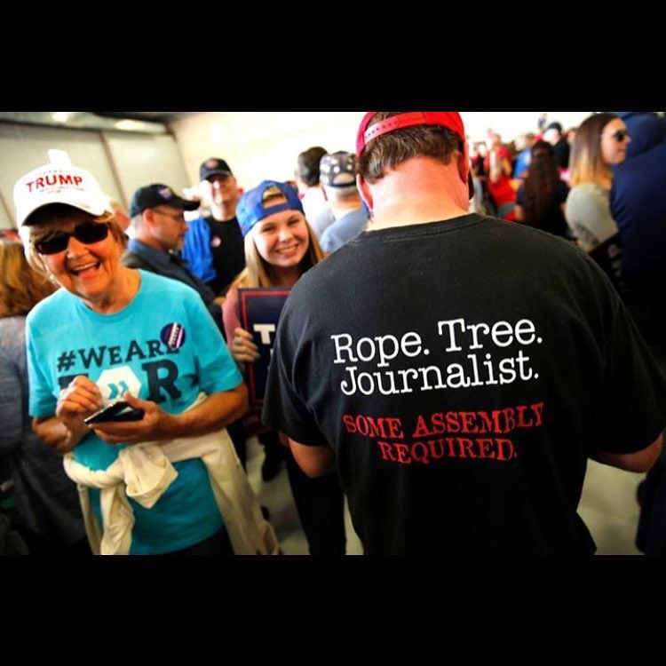 photo of man wearing t-shirt saying 'Rope, Tree, Journalist.  Some assembly required'