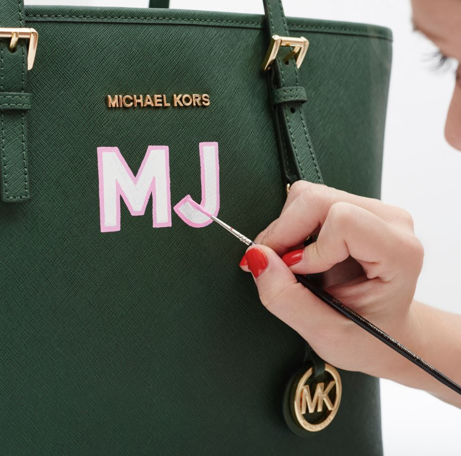 bec60a3f5b75 Have your initials hand-painted on your new @MichaelKors bag by Daisy  Emerson in store this weekend!
