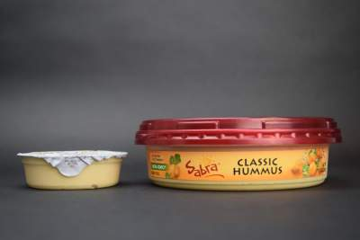 One serving of hummus is two level tablespoons. A petite single-serve holds  twice