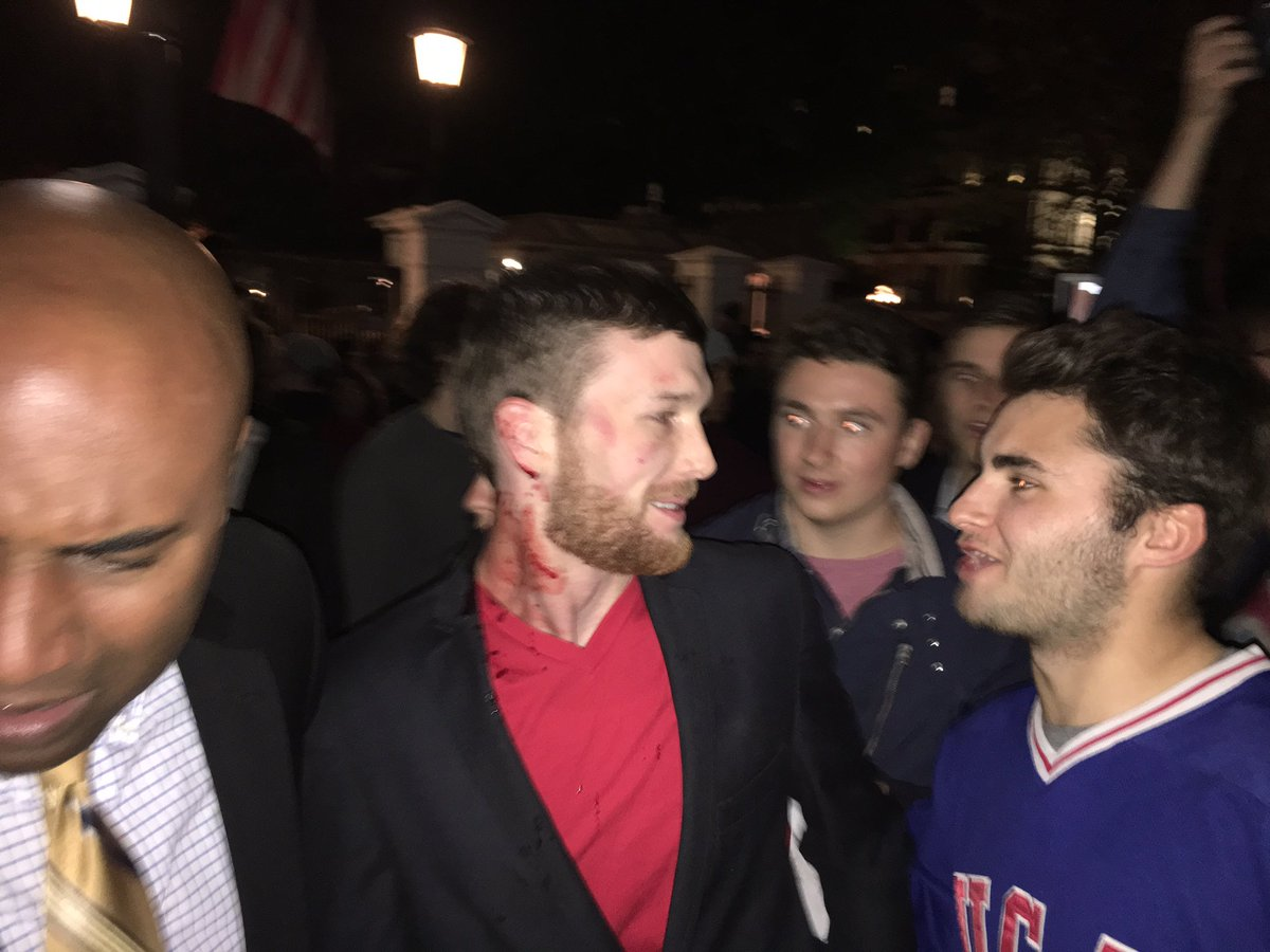 BREAKING: anti-trump protester has just bitten the ear of a #Trump supporter