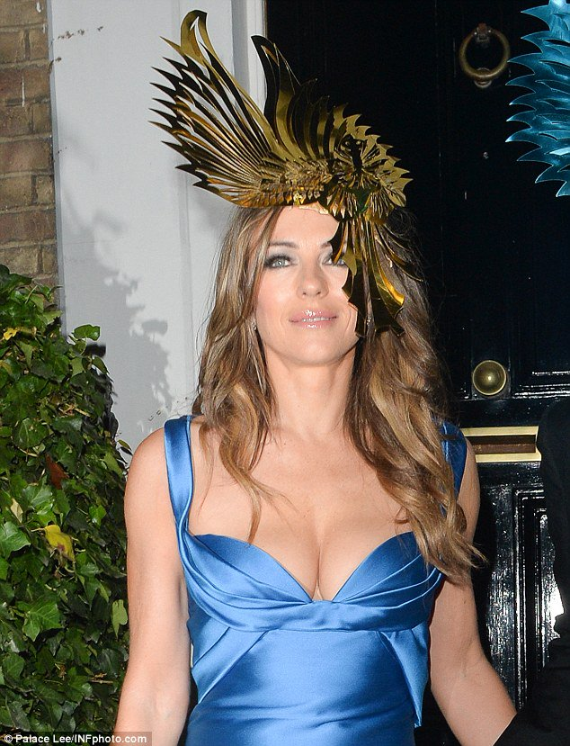 Liz hurley wows in an eagle-inspired fascinator for animal ball -  scoopnest.com d3bc5539f81