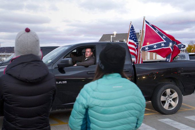 Cop Caught Trolling Anti-Donald Trump Protest With Confederate Flag On Pickup Truck