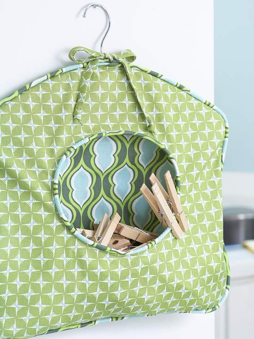 Get step-by-step instructions on how to make this laundry pin holder. diy