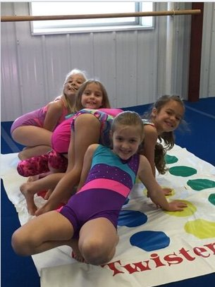 Little girls playing twister think