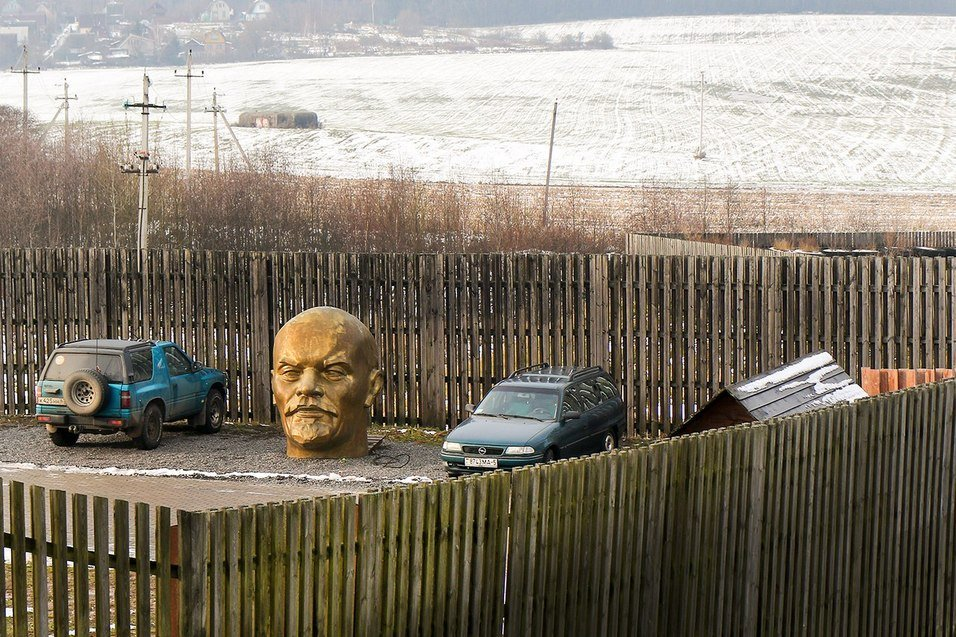 Giant golden Lenin head parked somewhere in fields of Belarus
