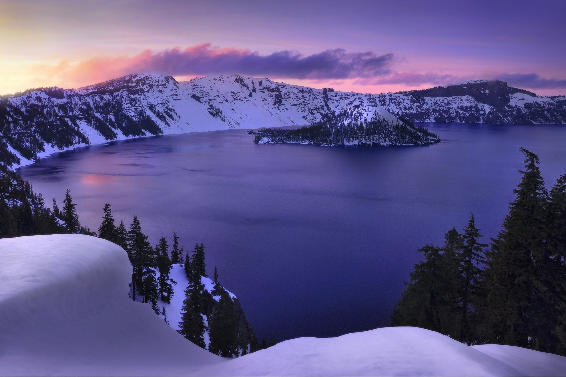 Purple sunset over a snowy crater lake