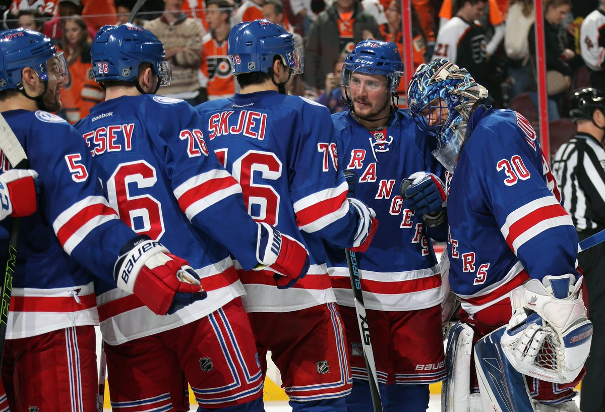 Teammates congratulate Henrik Lundqvist following a season high 40 saves that bailed the Rangers out in a 3-2 win over the Flyers on Black Friday. AP Photo via Getty Images courtesy NYRangers.