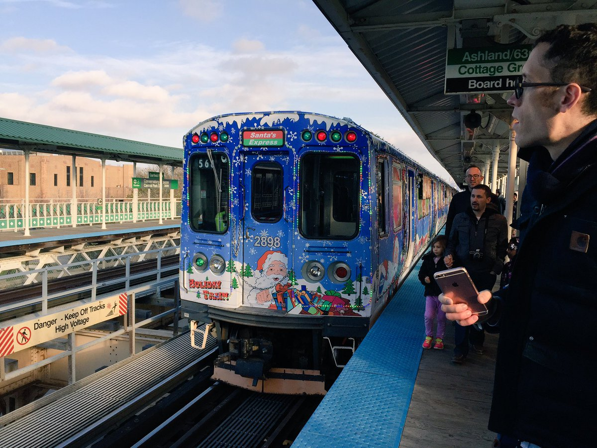 cta on twitter the holiday train is in green line service to ashland63rd via downtown wthe elves workshop train just behind it