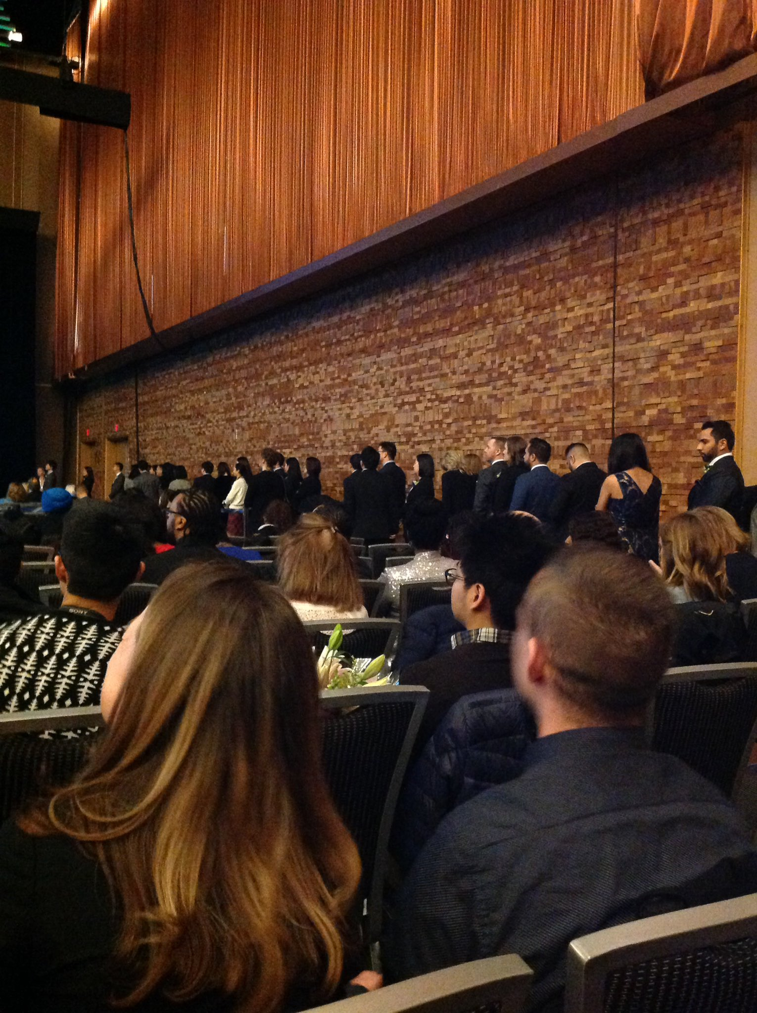 Graduates lining up to take the stage at CPABC's convocation. Congrats to you all! #CPABCGrads https://t.co/QViXkVFg8e