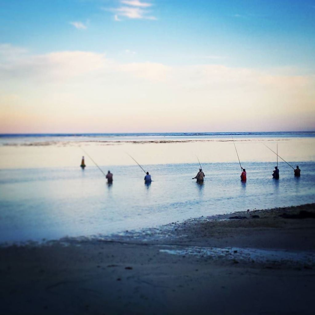 Watching the local fishermen while the sunsets. #Mauritius #holiday #sunset #beach - http://ift.tt/1qGuSlz
