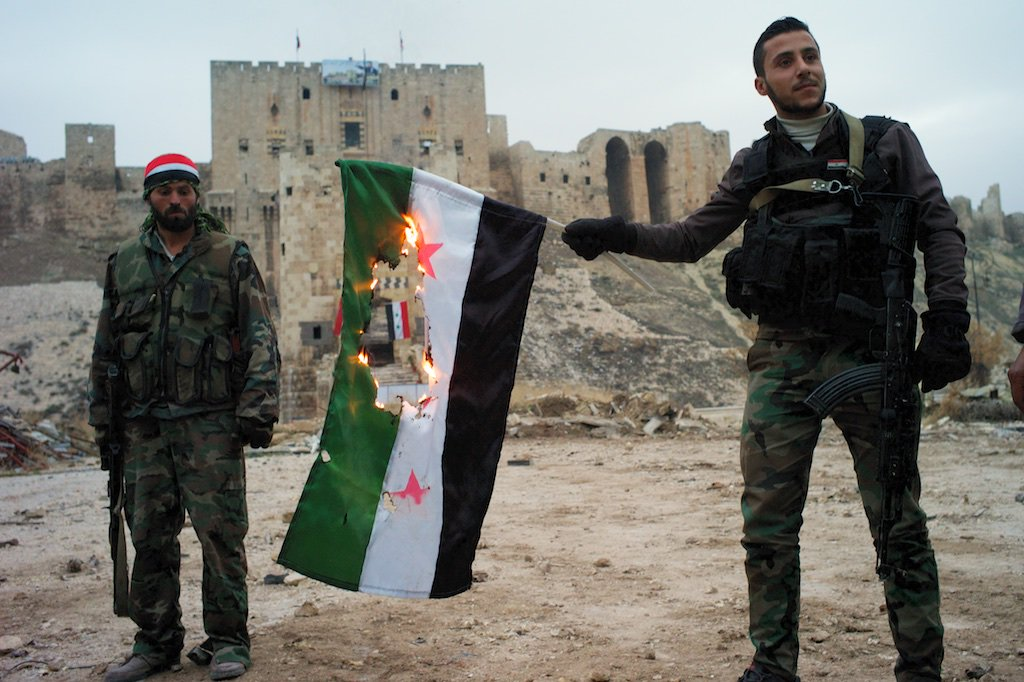 Image result for Syrian army burn revolutionary flag in Aleppo