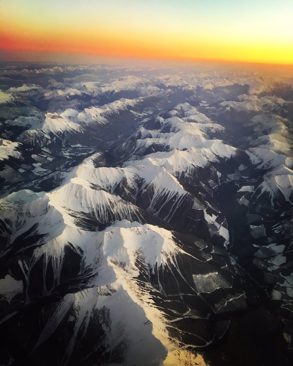 Flying over the Rockies at sunset ain't too shabby. https://t.co/xix9BPyAMF