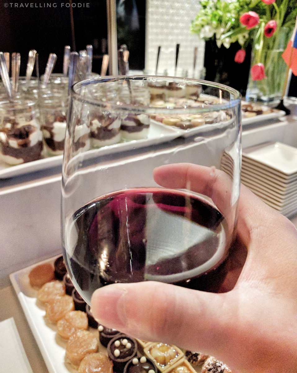 Travelling Foodie drinks wine at Mastercard Cash Passport Preview Night at The One Eighty