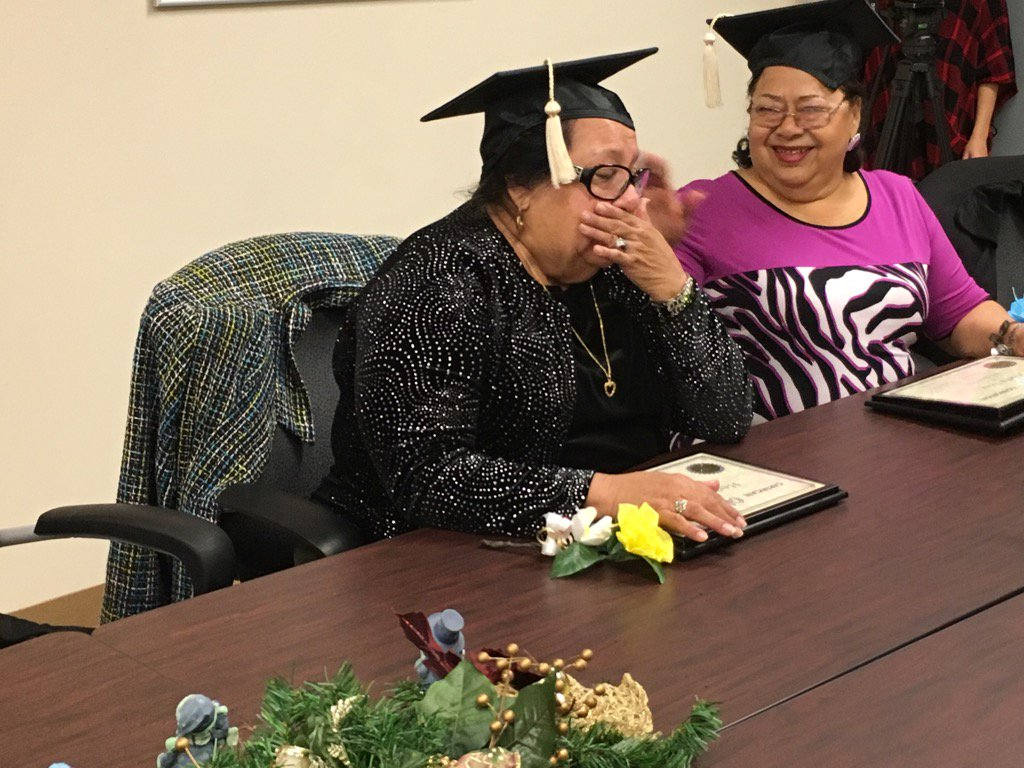 Herlinda Arias weeps with joy after graduating from English as a Second Language class at Cisneros Senior Center.
