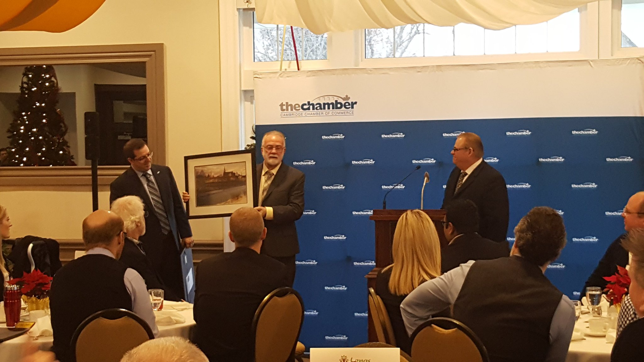 Presentation of Alex's prints to Cambridge Mayor Doug Craig & Guelph Mayor Cam Guthrie as Thank You gifts during a Cambridge Chamber of Commerce December 2016 morning event.